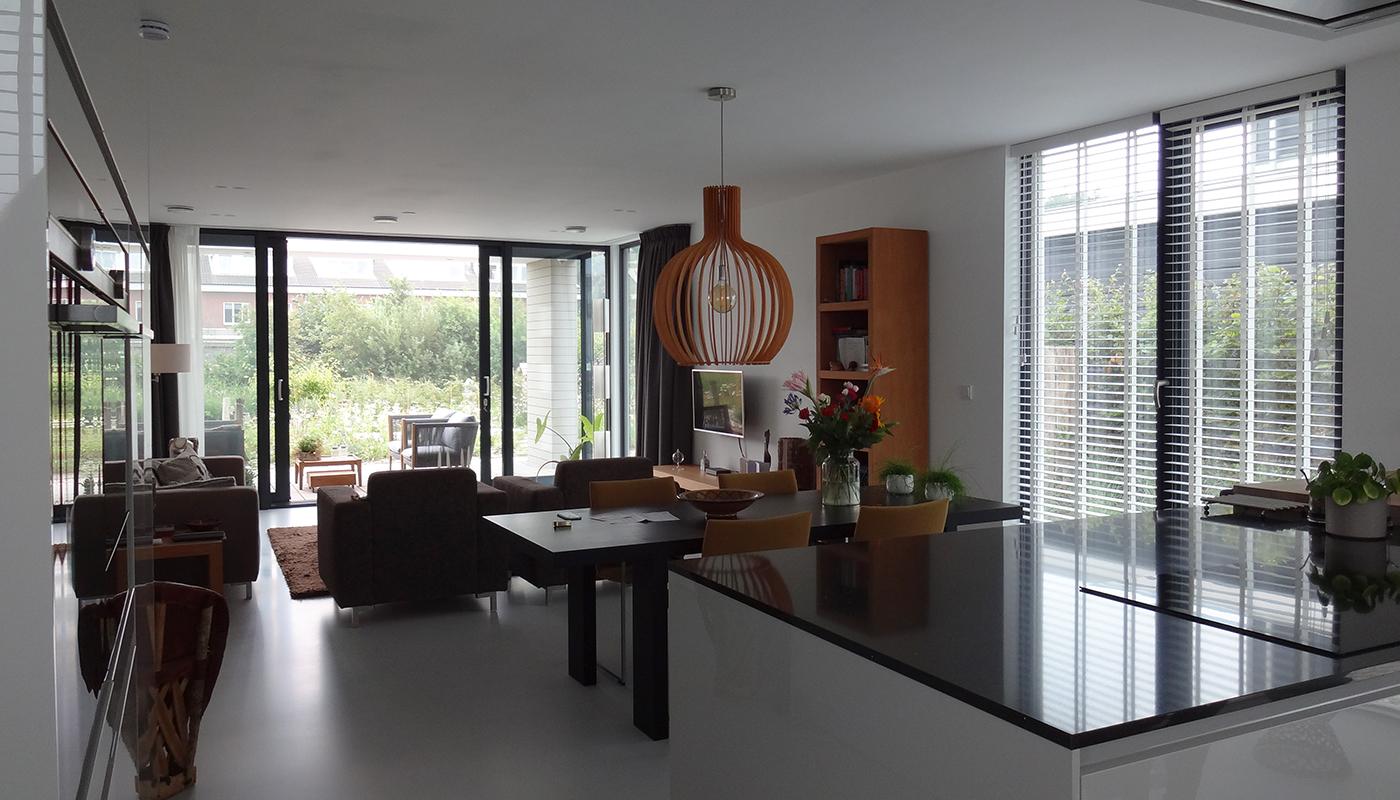 Interieur woonkamer eethoek zithoek